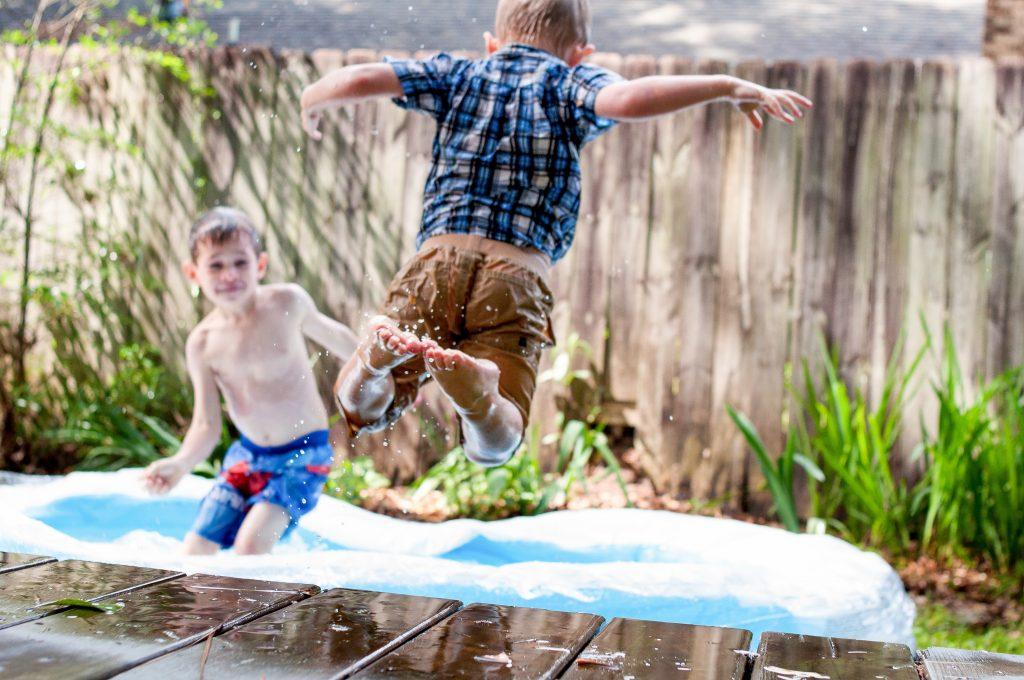 Boys splashing summer holidays